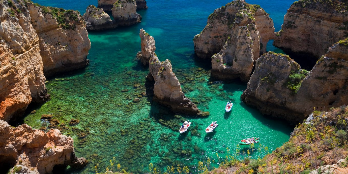 The best places to treavel in October, view of blue green waters in the Algarve, Portugal