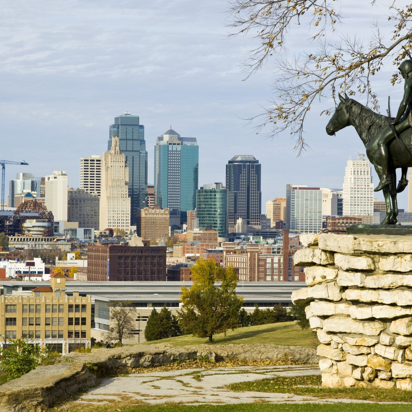 A view of downtown Kansas City, Missouri with the Scout statue in the foreground