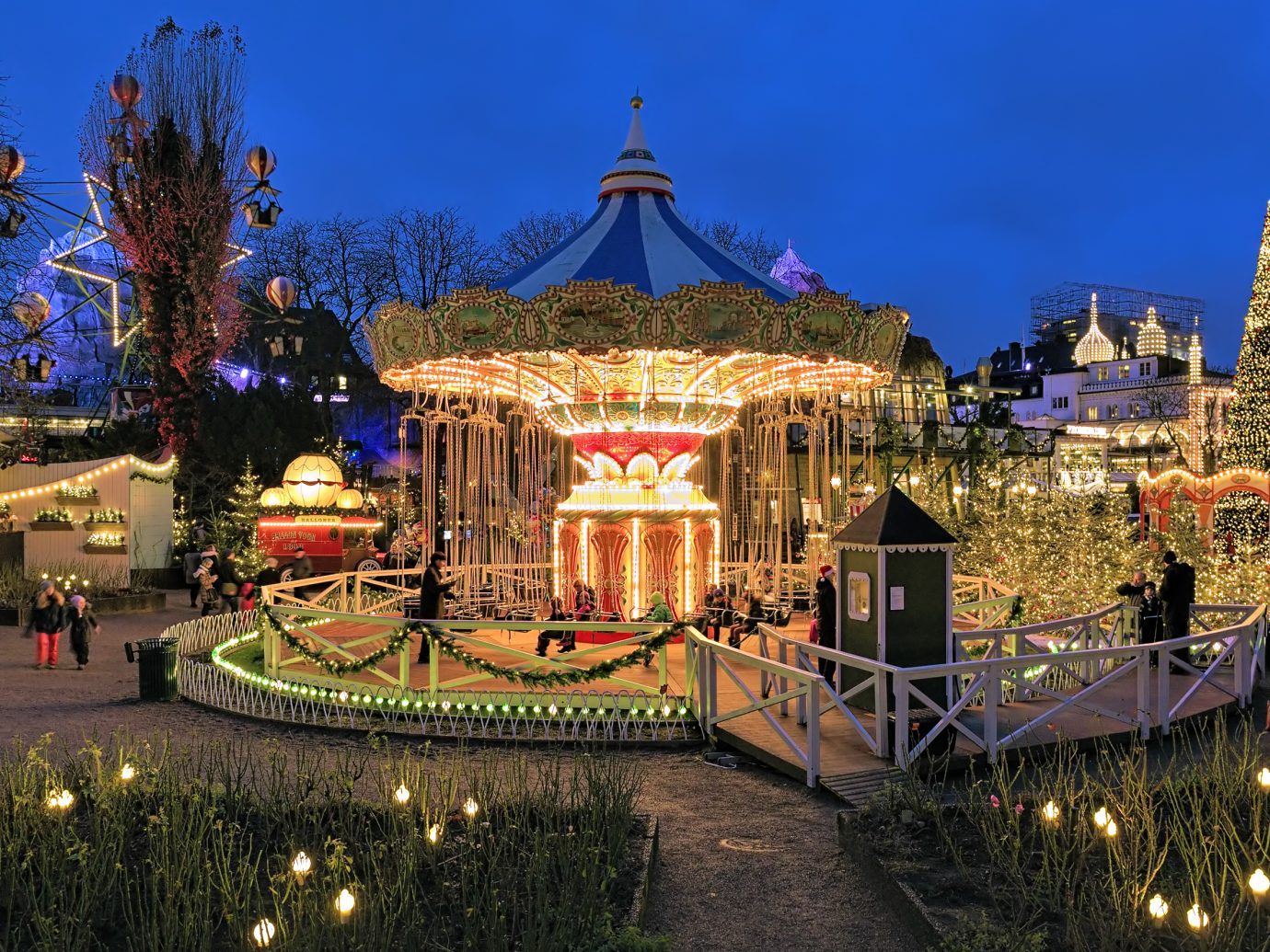 Chain carousel and christmas illumination in Tivoli Gardens. Tivoli Gardens is a famous amusement park and pleasure garden; it is the most-visited theme park in Scandinavia.