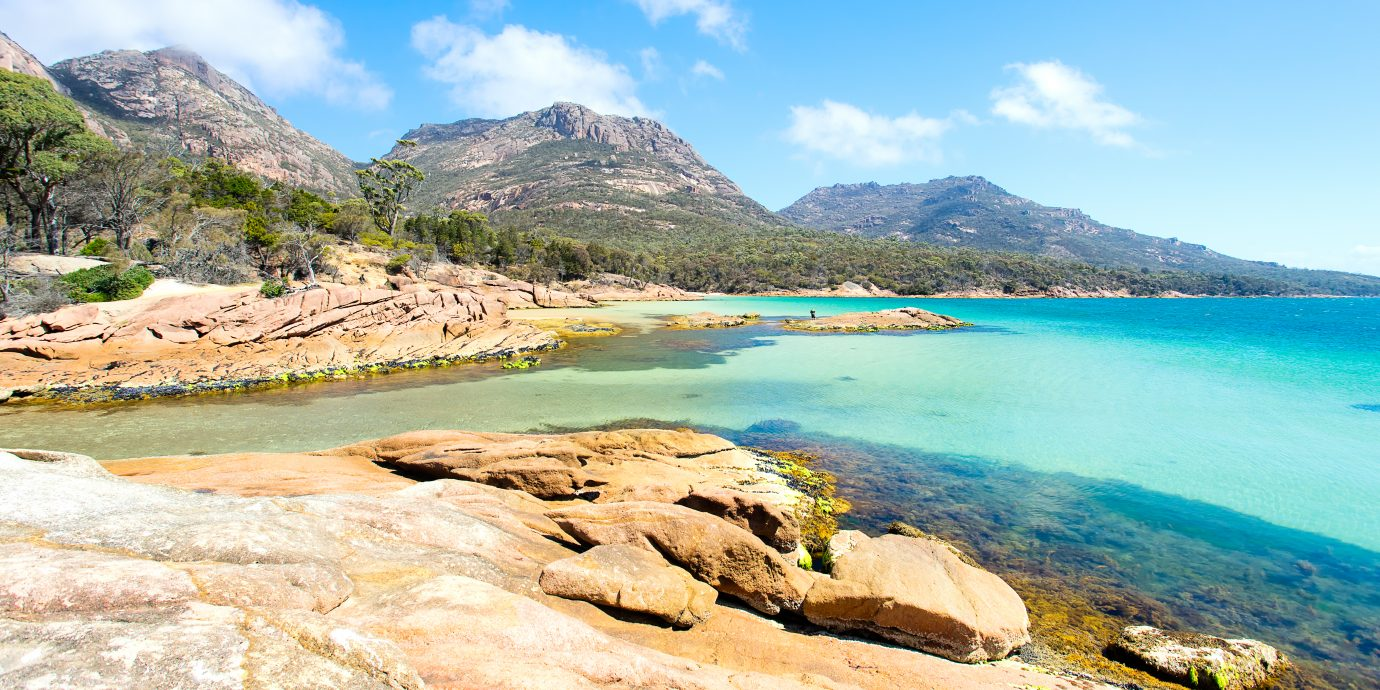 Honeymoon Bay in the Freycinet National Park on a clear day with blue water