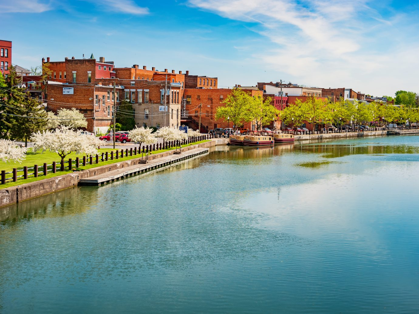 Stock photograph of park and promenade in downtown Seneca Falls and the Cayuga–Seneca Canal in the Finger Lakes region, upstate New York State, USA on a sunny day.