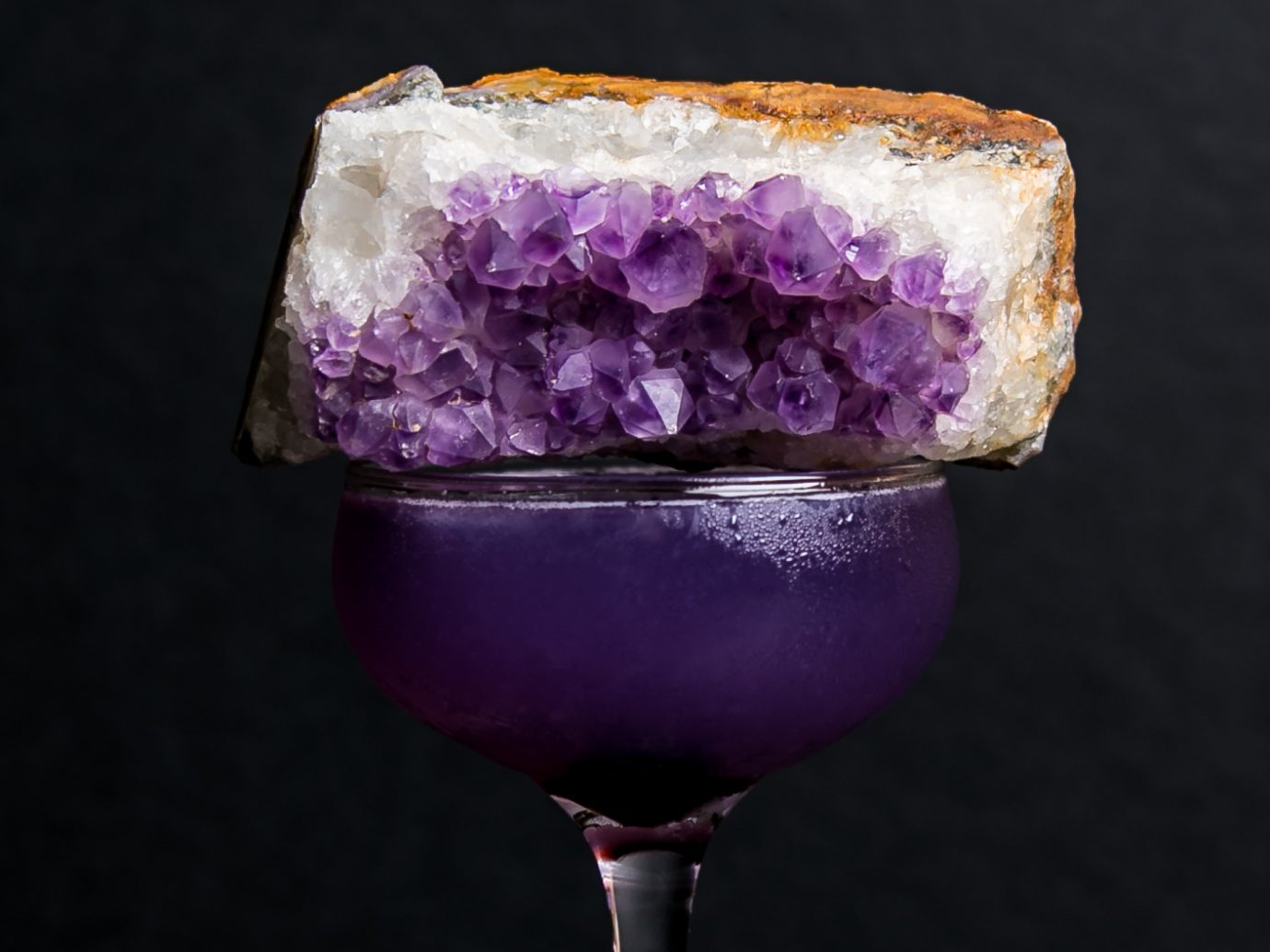 A purple Sundry + Vice cocktail, a classic Aviation called the Amethyst. It's butterfly pea-infused gin, maraschino, Creme de Violette, and lemon