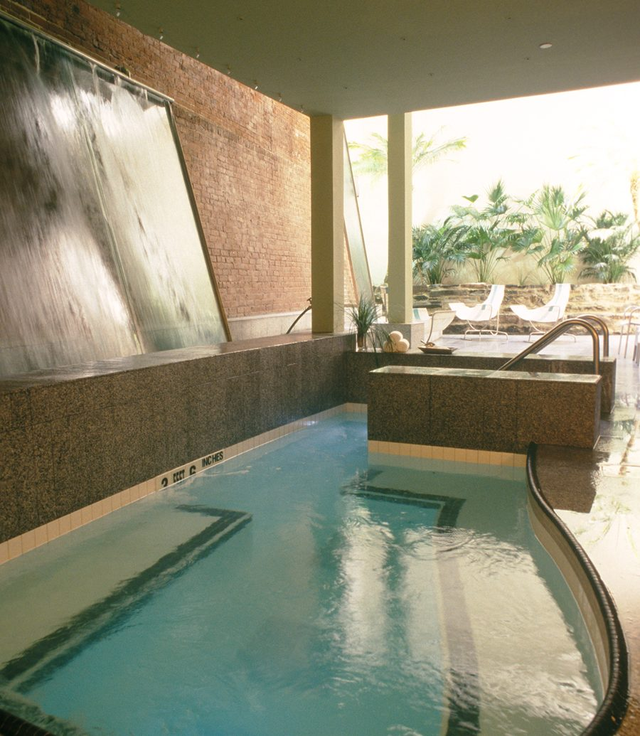 Indoor pool with waterfall decoration at Great Jones spa