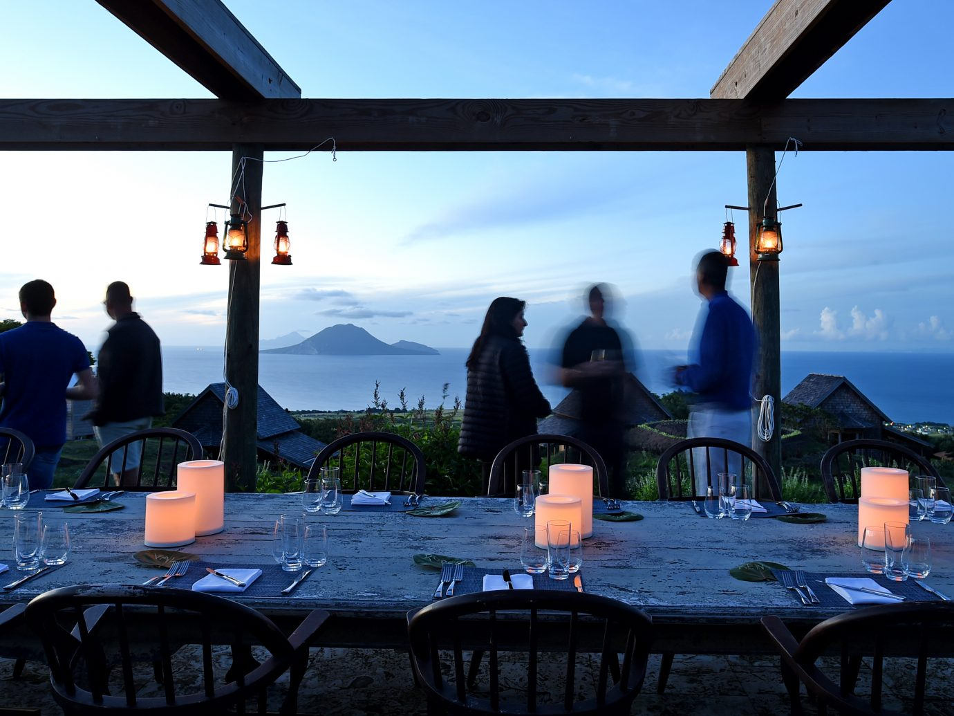 Farm to table experience with people socializing at dusk with a beautiful background