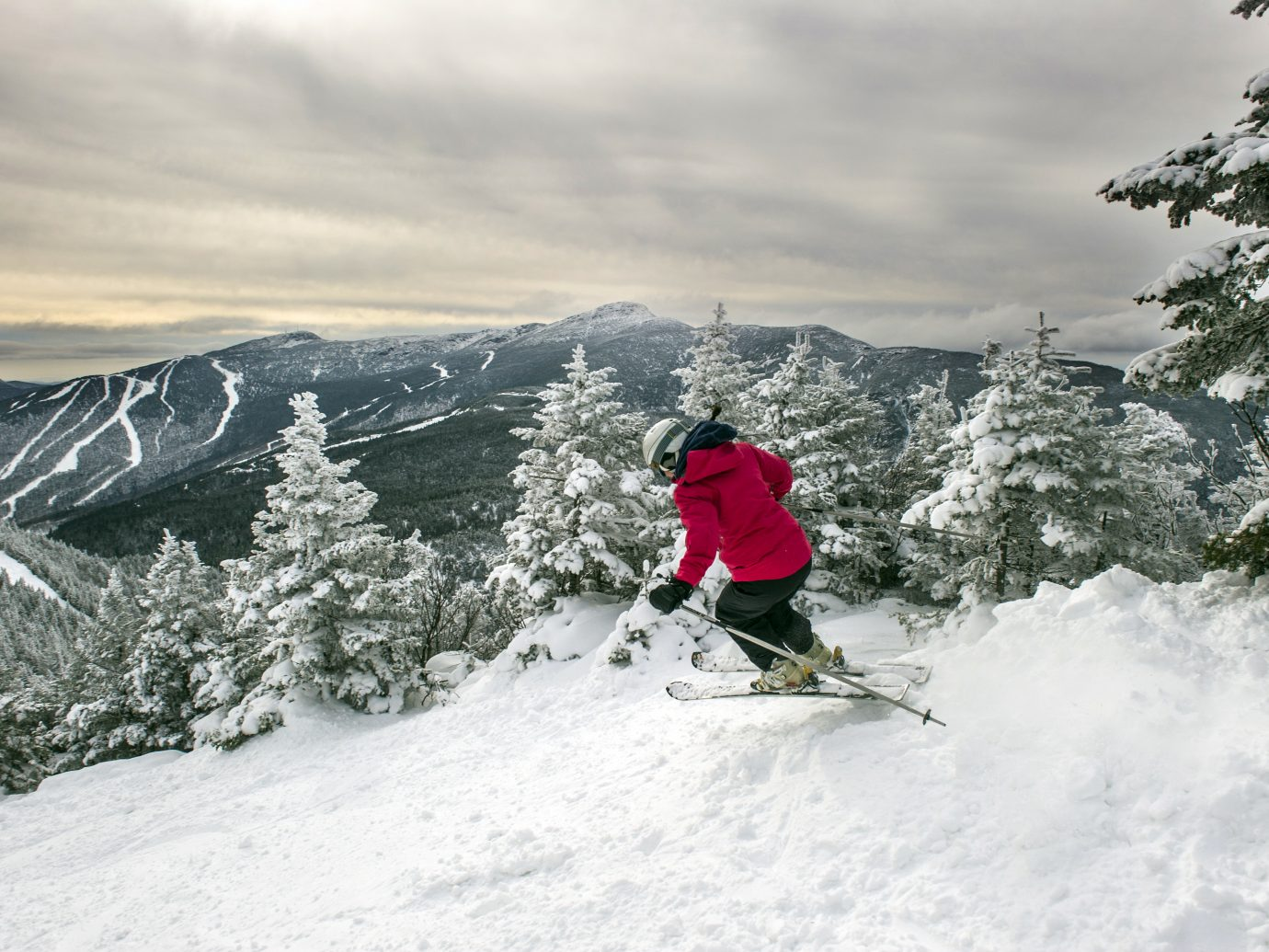 Person in red skiing down slopes at Smuggler's Notch