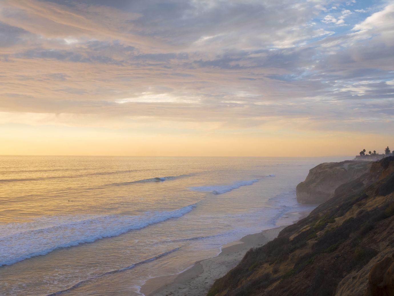 Surfers enjoying waves at sunset at San Diego's North county beaches near Encinitas and Carlsbad California