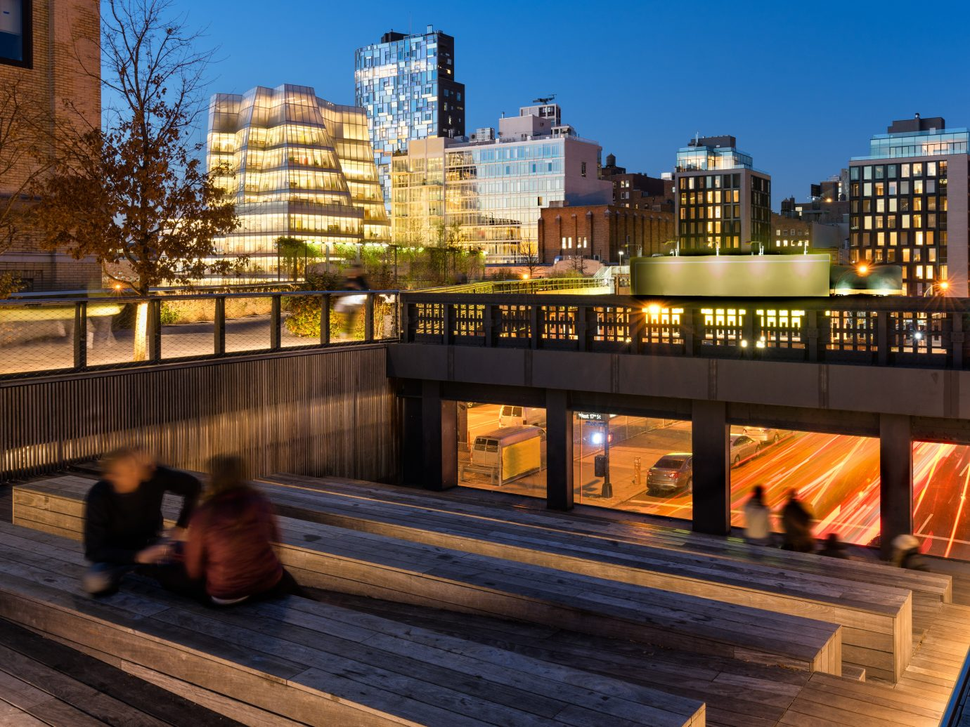 CROP of The High Line at twilight with a view on 10th Avenue with skyscrapers and building illumination. Chelsea, Manhattan, new York City, USA