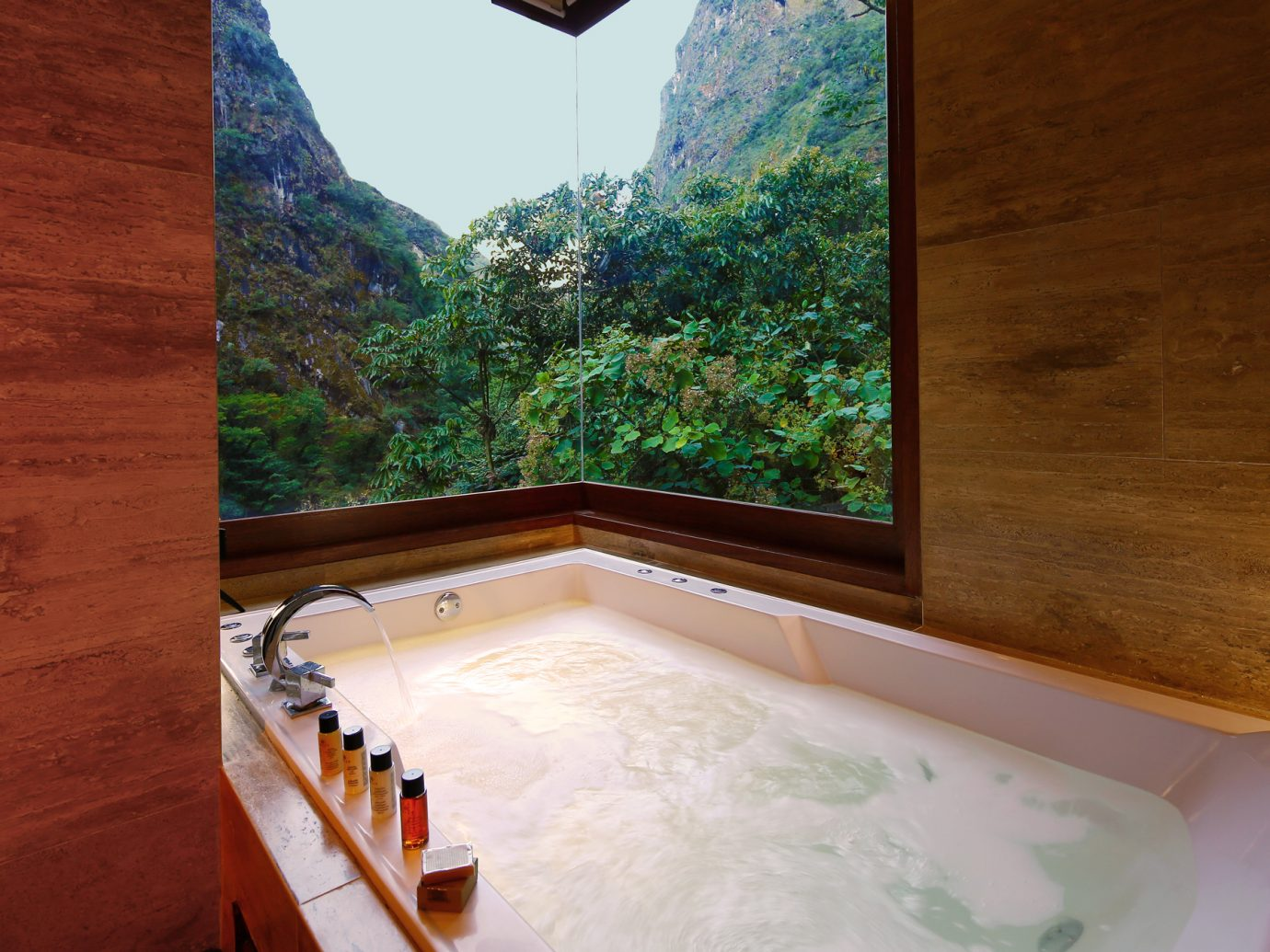 Luxurious bathtub in the imperial suite at SUMAQ overlooking lush Peruvian mountains