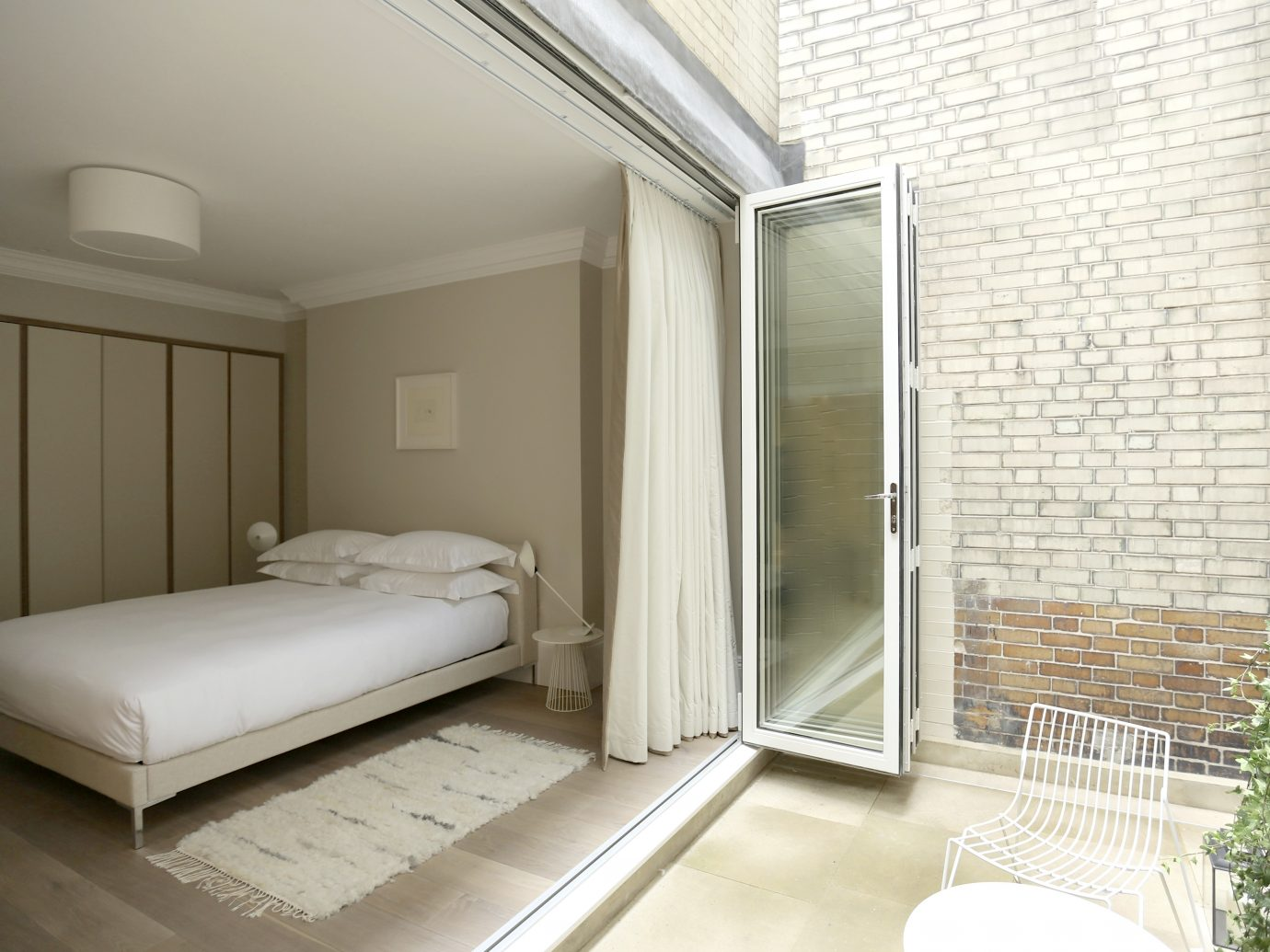 Bed open to outside at the Welbeck portion of the Living Rooms in London