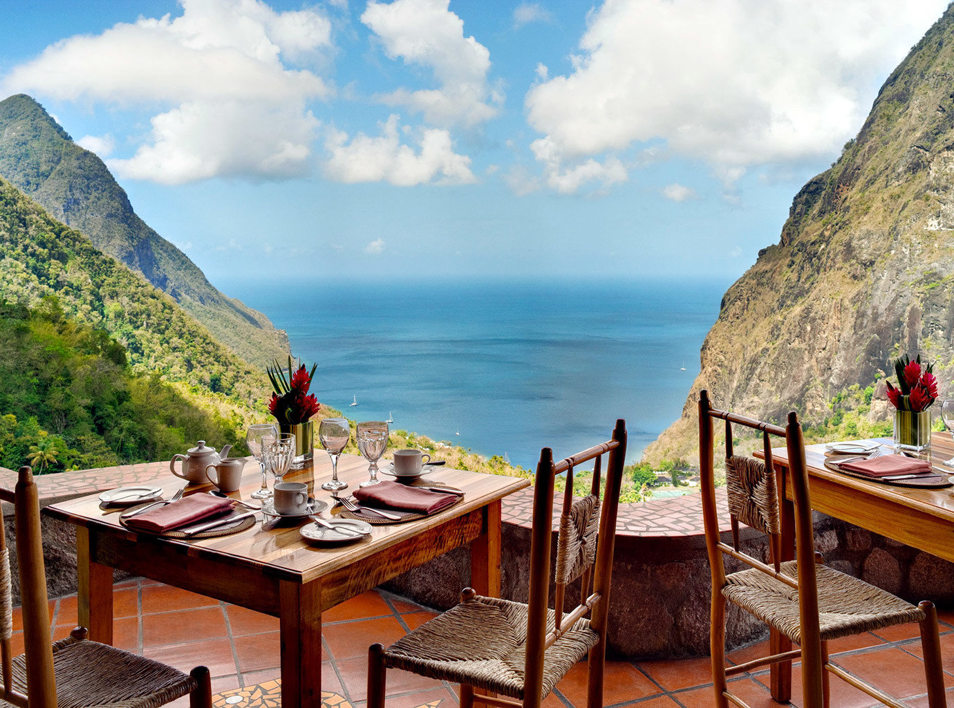 Outdoor seating overlooking beautiful blue water and pointy mountains at Ladera Resort