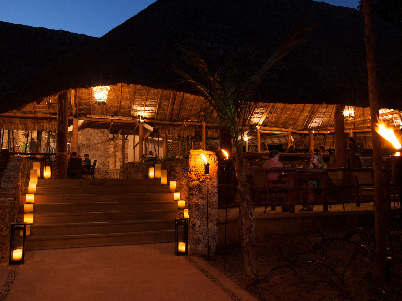 Night time eating lit with candles at Mahekal Beach Resort