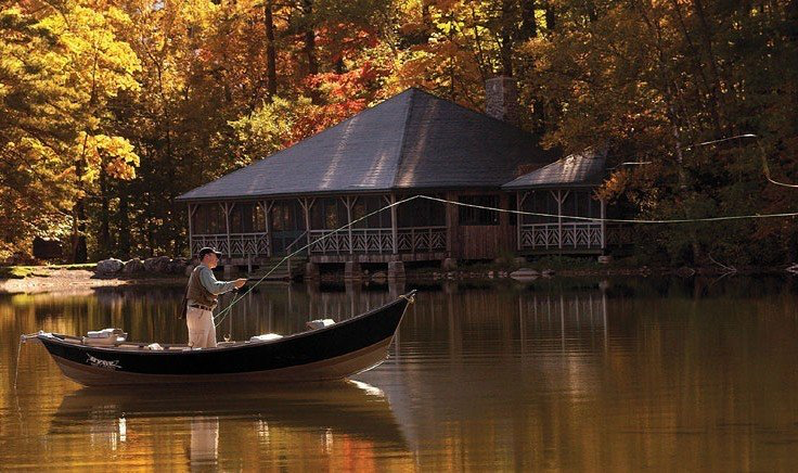 Man fishing on boat in autumn at Equinox Golf Resort & Spa
