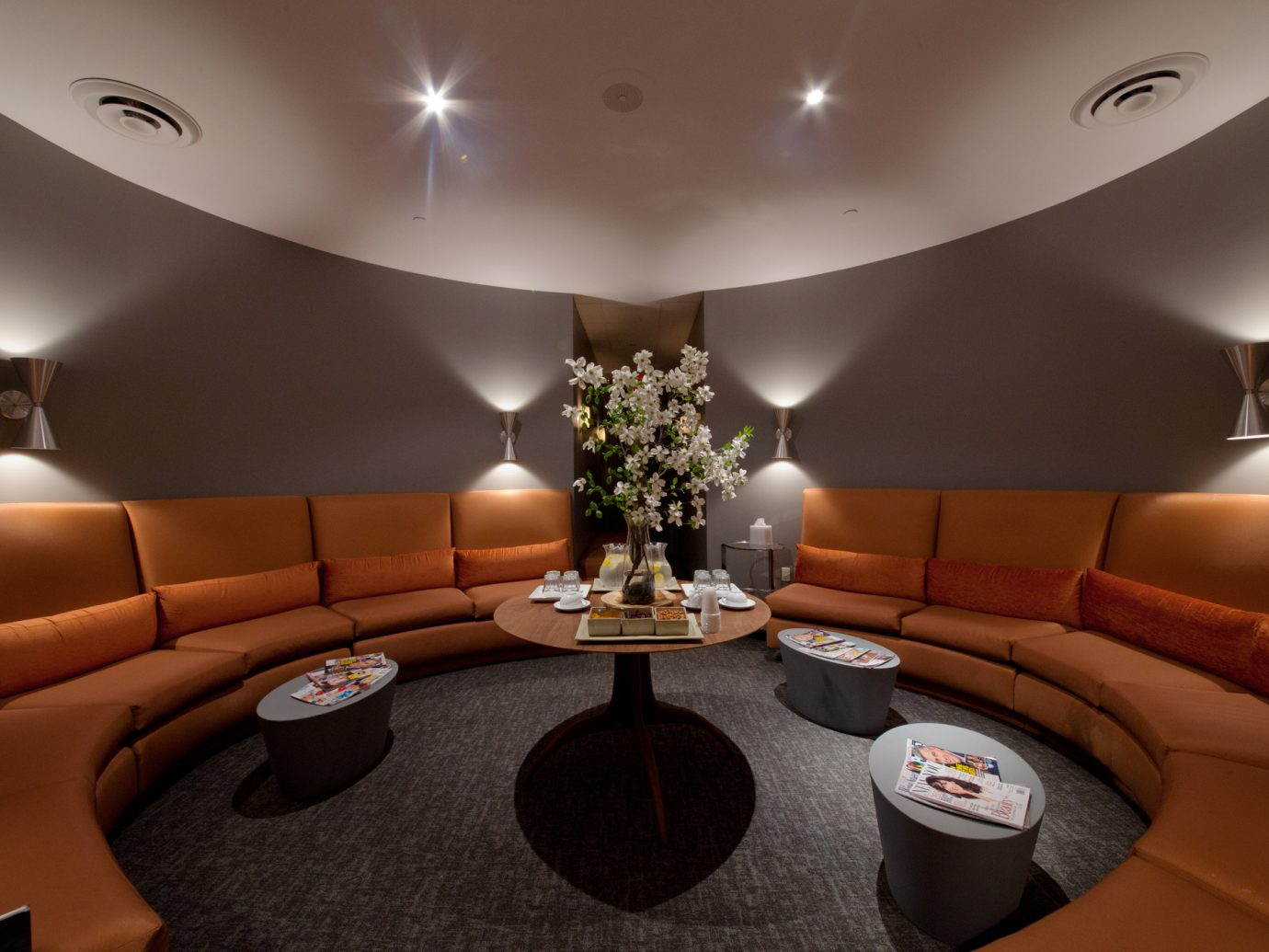 Round orange booth at the waiting room at Oasis Day Spa in NYC