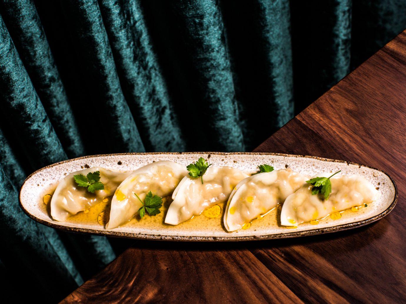 Dumpling dish at edge of table