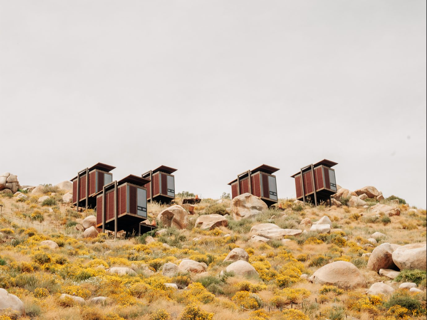 Small hotel room pods in the middle of a dry landscape