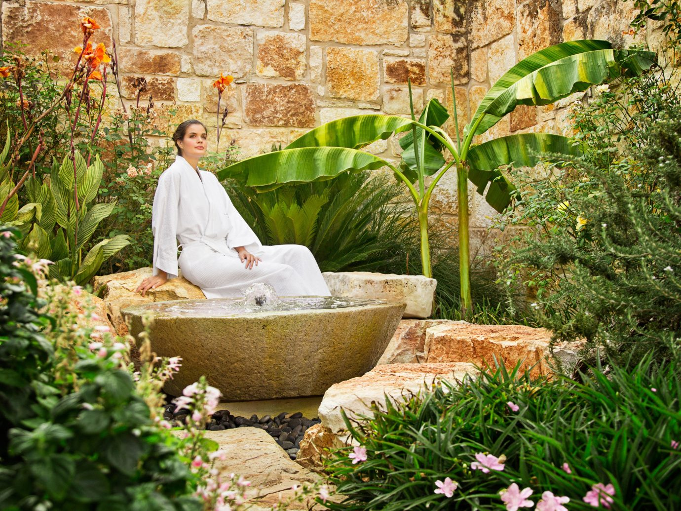woman in the garden at Lake Austin Spa Resort