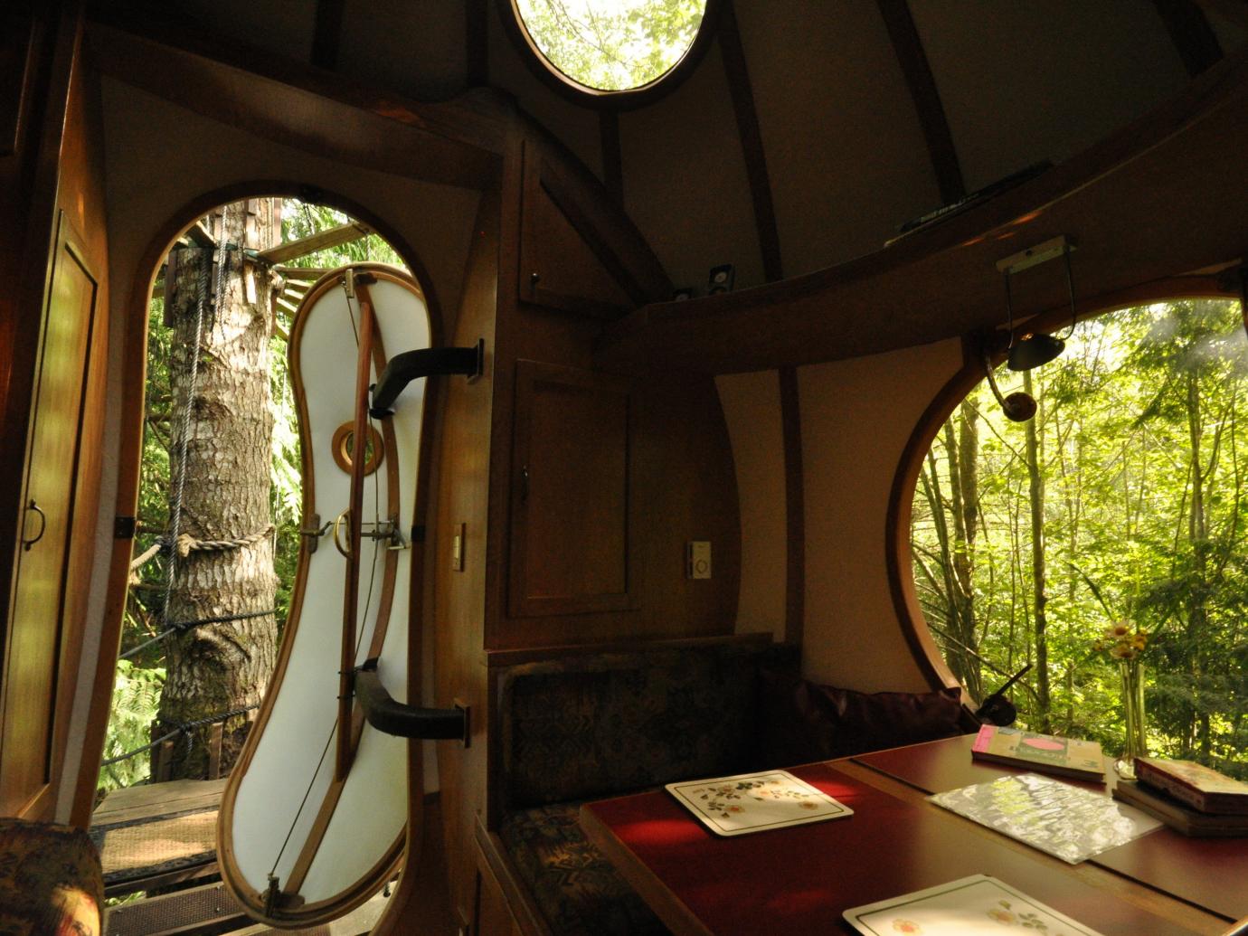 Room interior with open door in spherical hotel room
