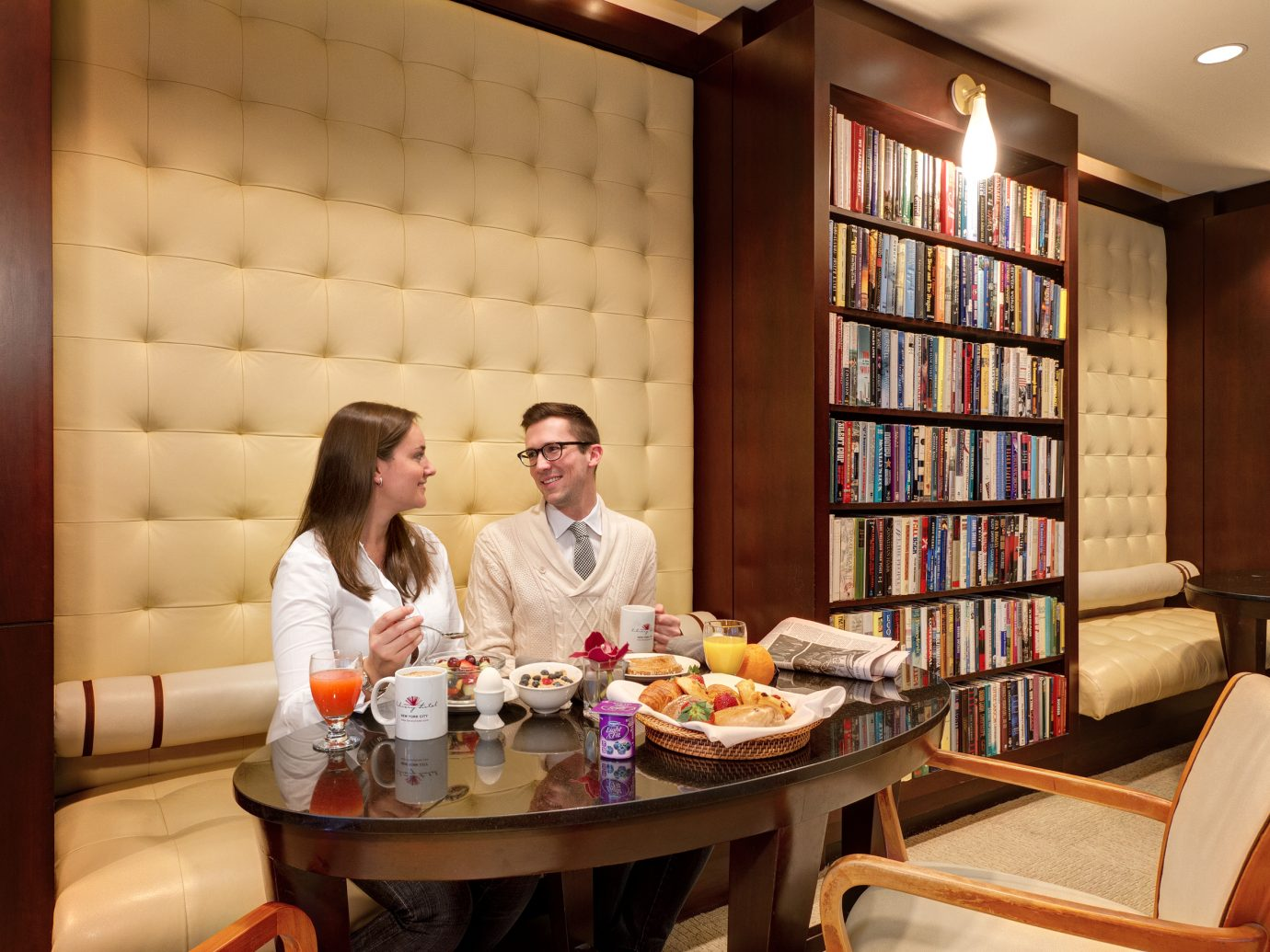 Couple enjoying food in Reading Room