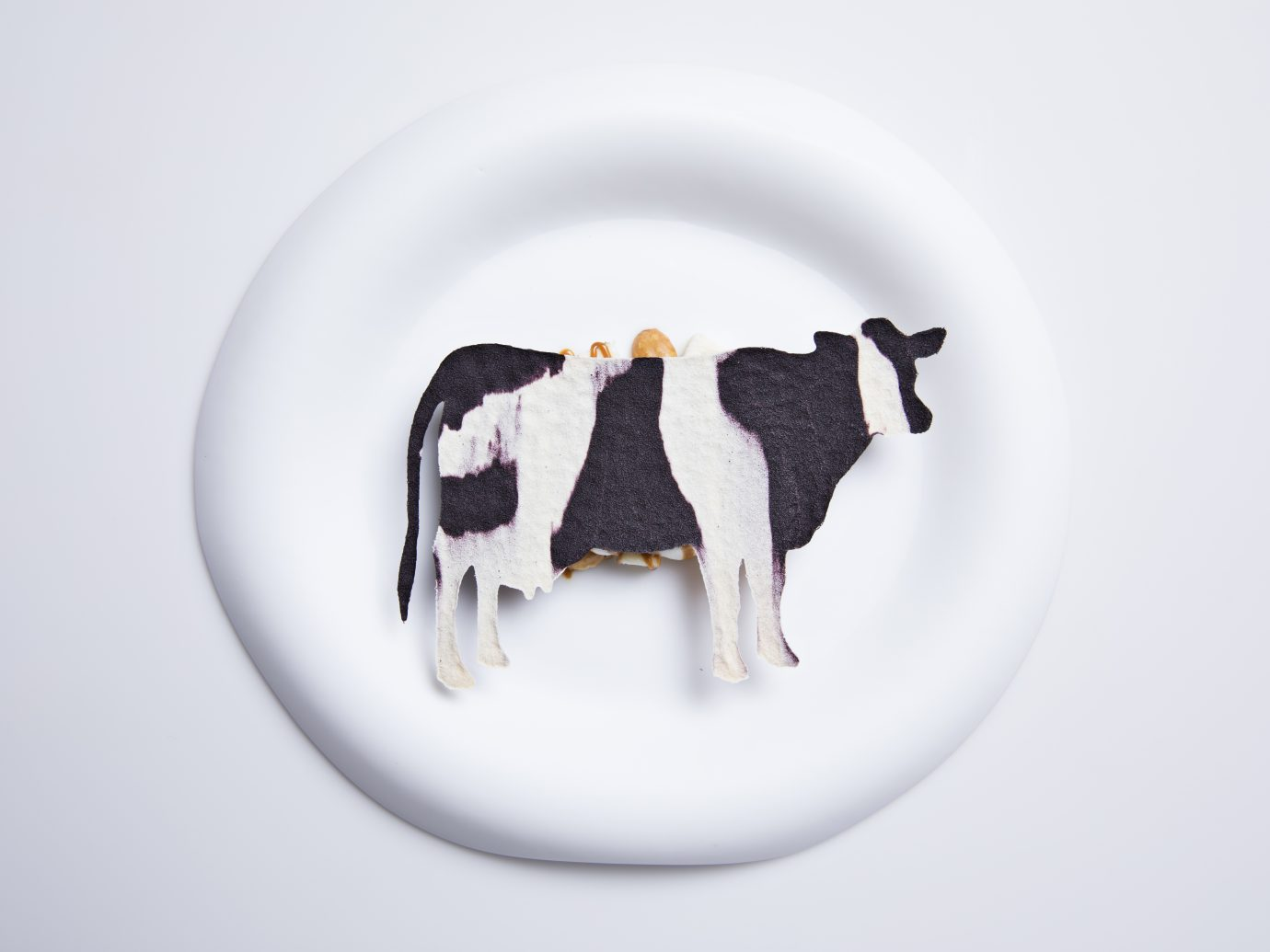 food with cut out of a cow on top