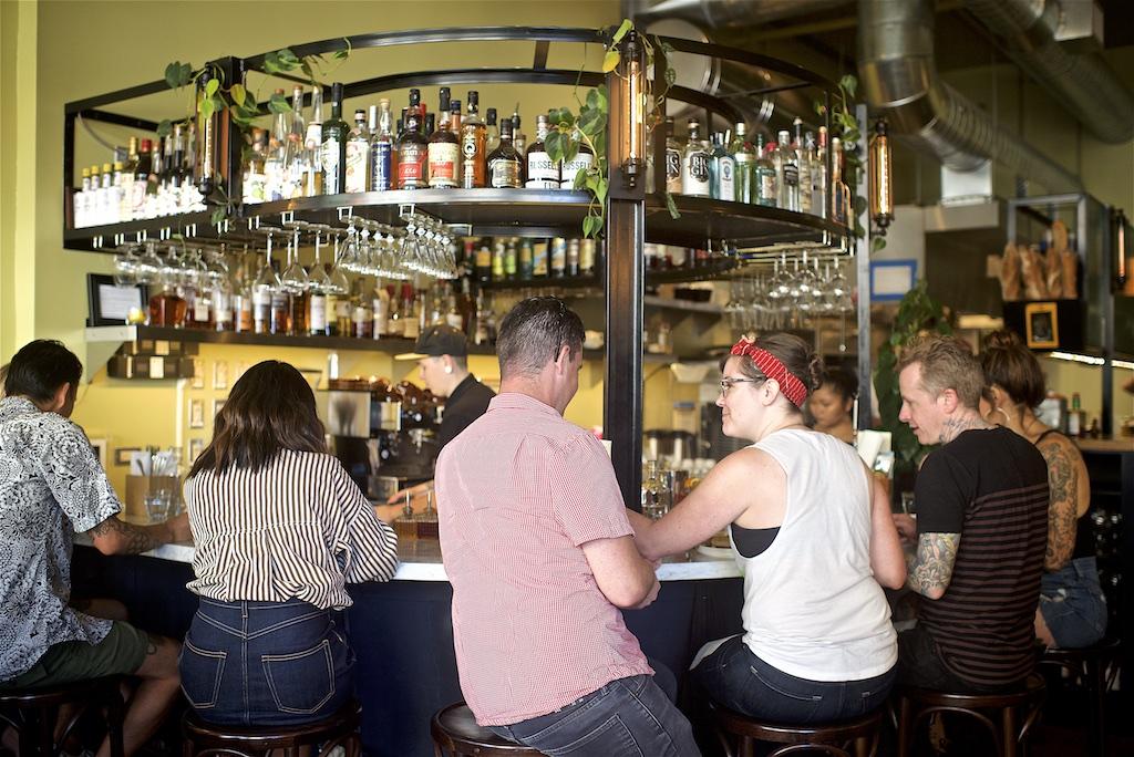People hanging out at a circular bar