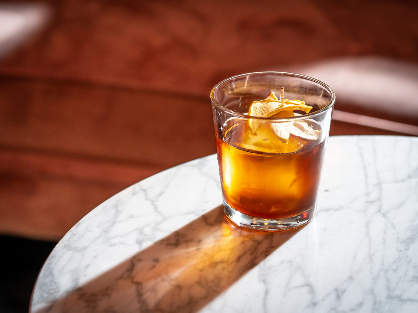 brown alcoholic drink in cup
