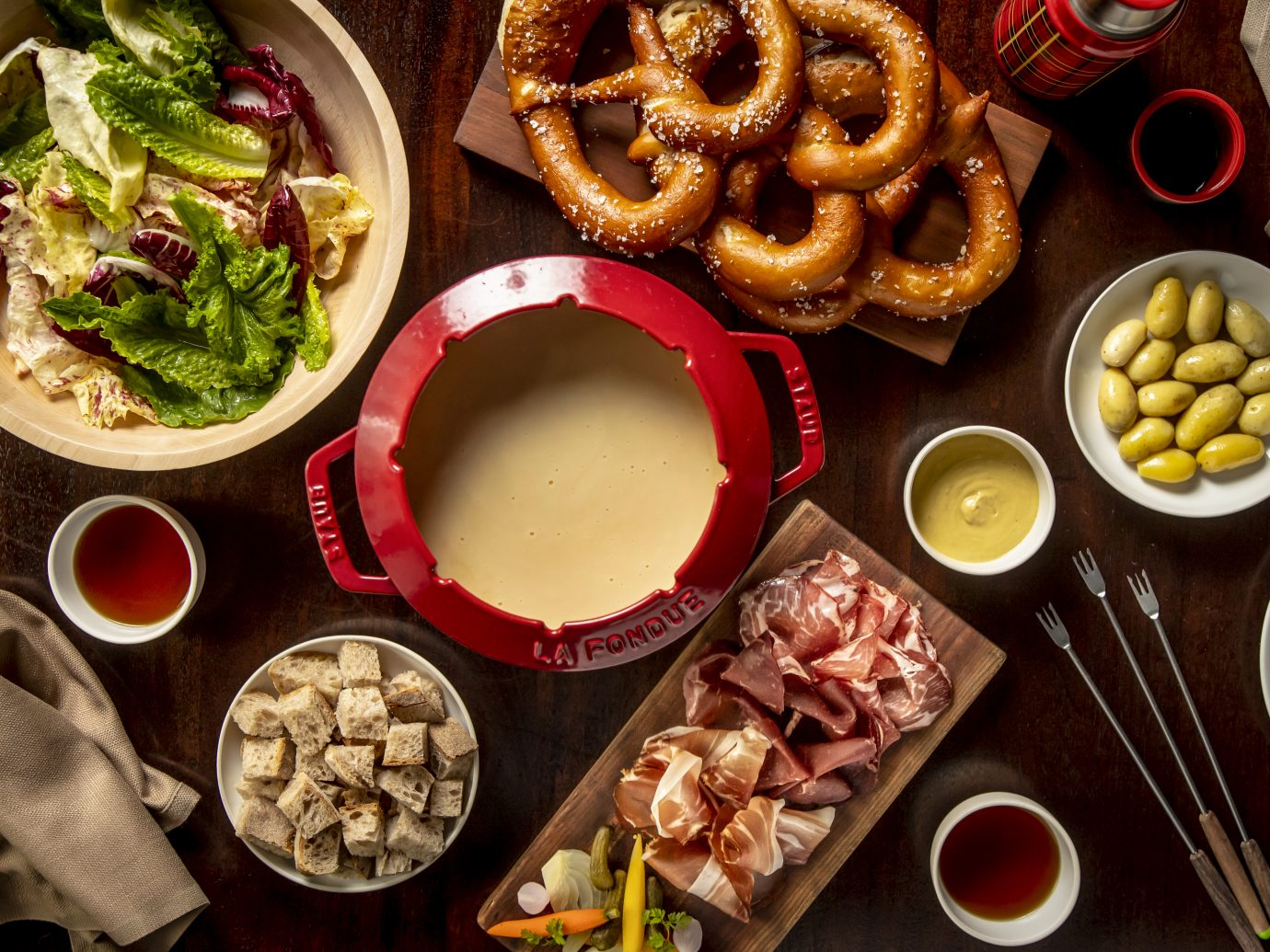 fondue with an assortment of foods to dip in it