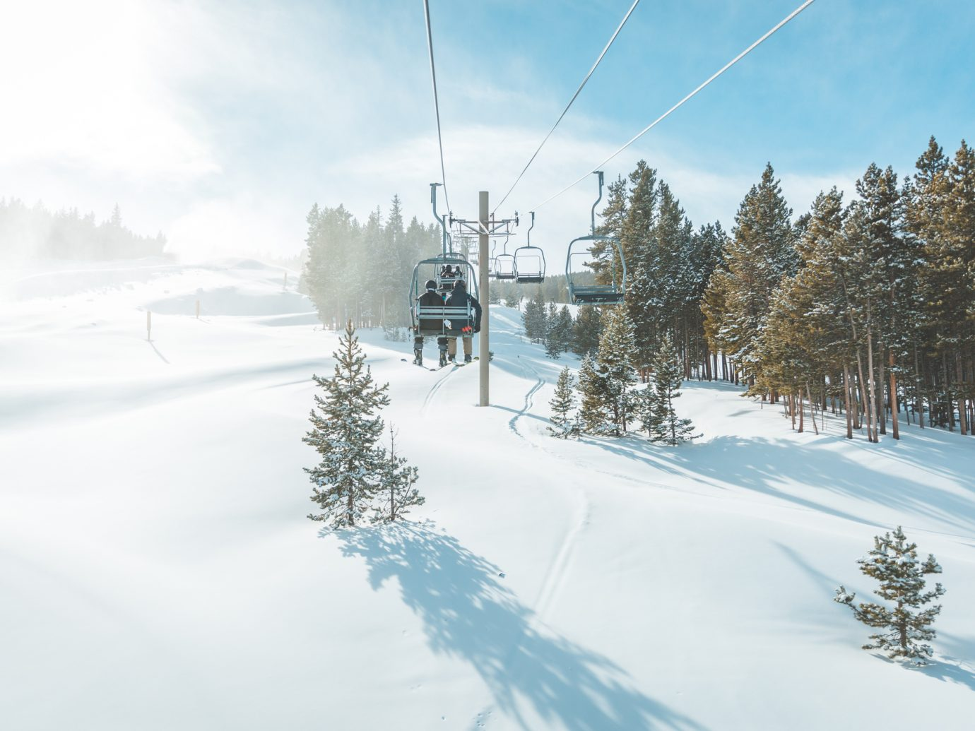 Breckenridge, United States - December 2, 2018: View of untracked ski slope and ski lift in Breckenridge ski resort.