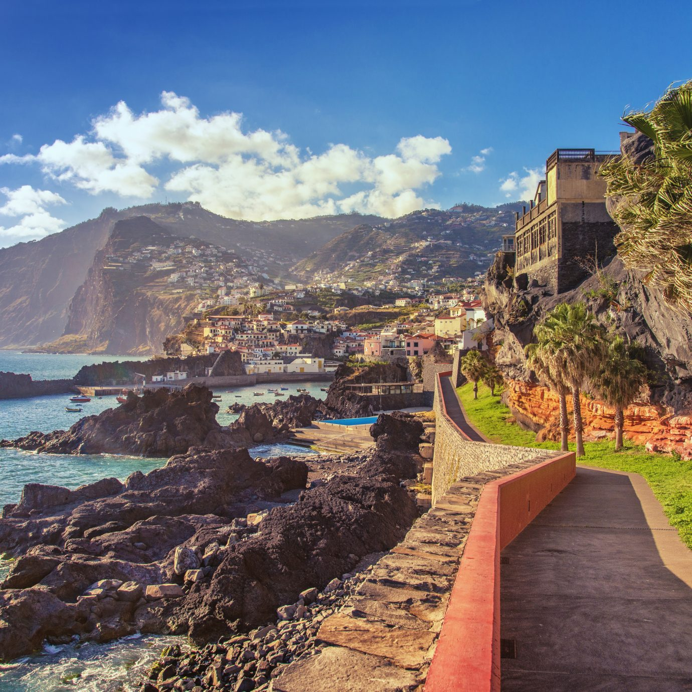 The beautifil Promenade walk from Funchal Lido into the fishing viallge of Camara de Lobos on Madeira at sunset