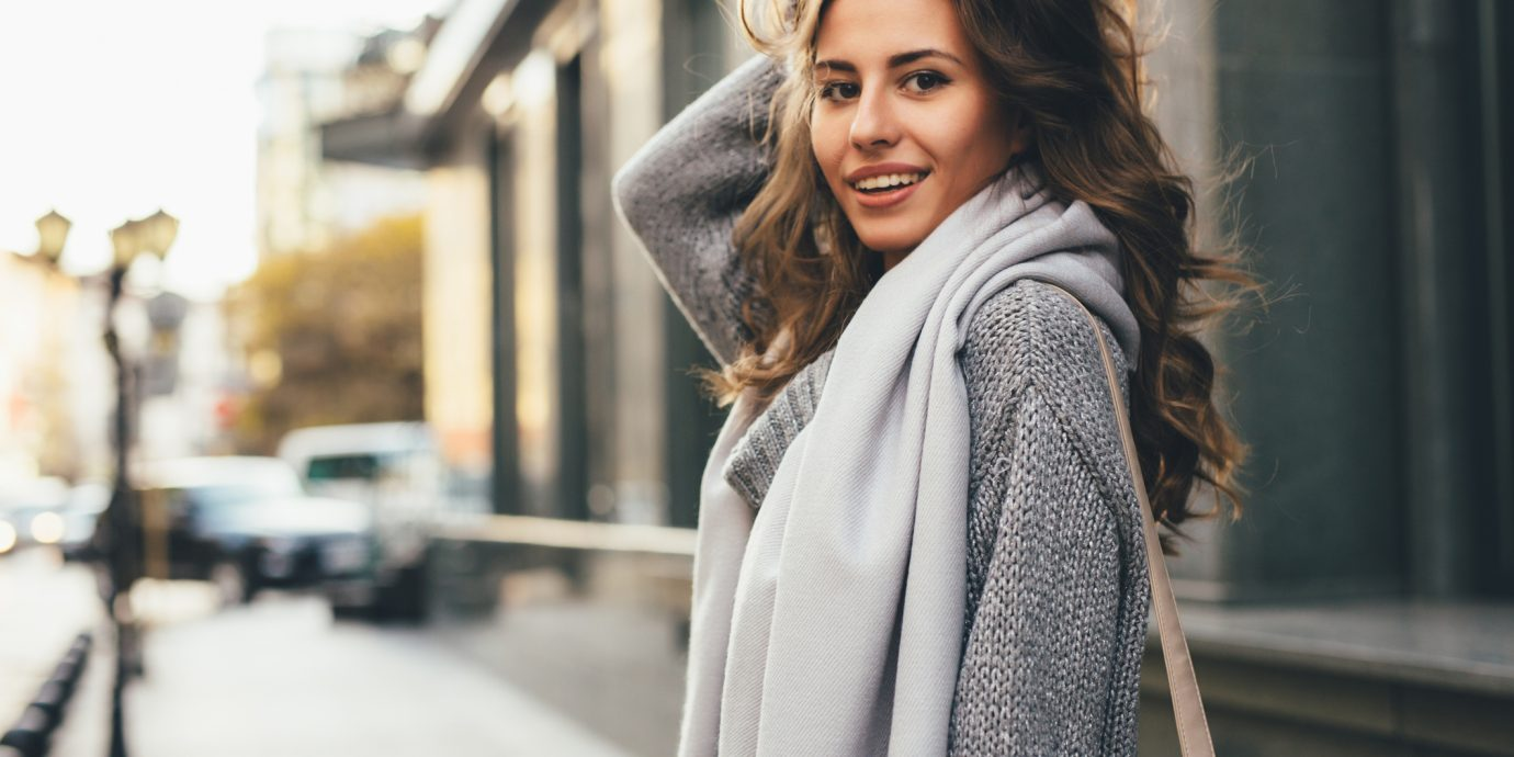 Portrait of a beautiful young woman in a cozy sweater