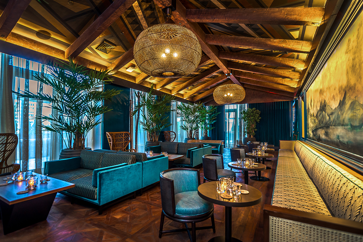 dark, tropical interior with numerous seating options