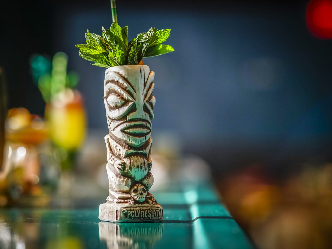 tiki drink with leaves sticking out