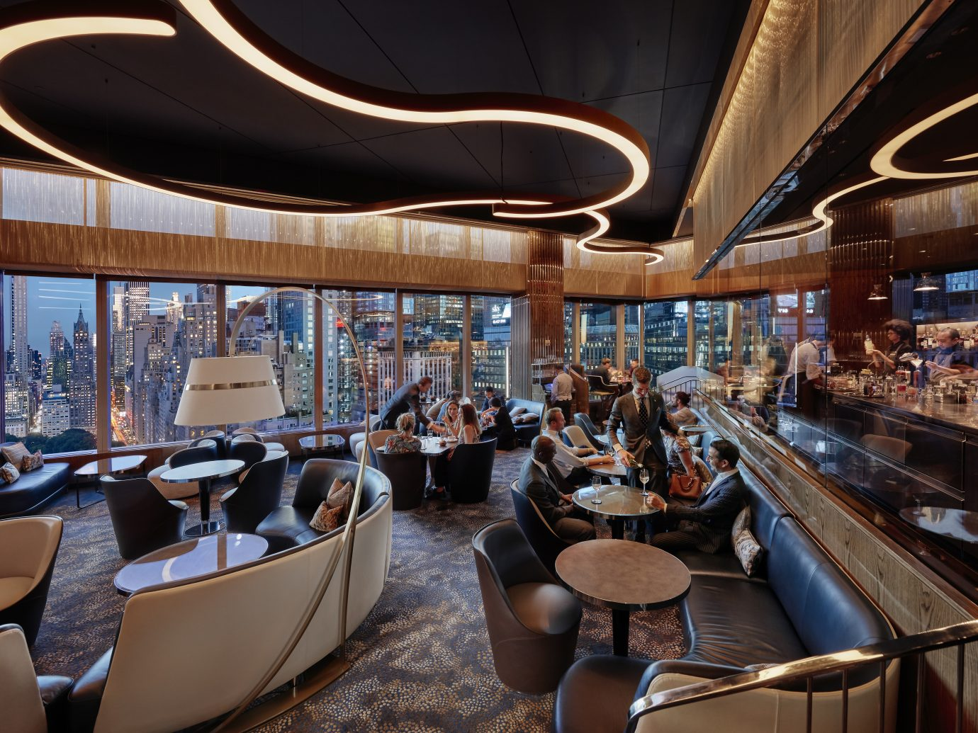 great lounge area with beautiful curvy ceiling lights and tables