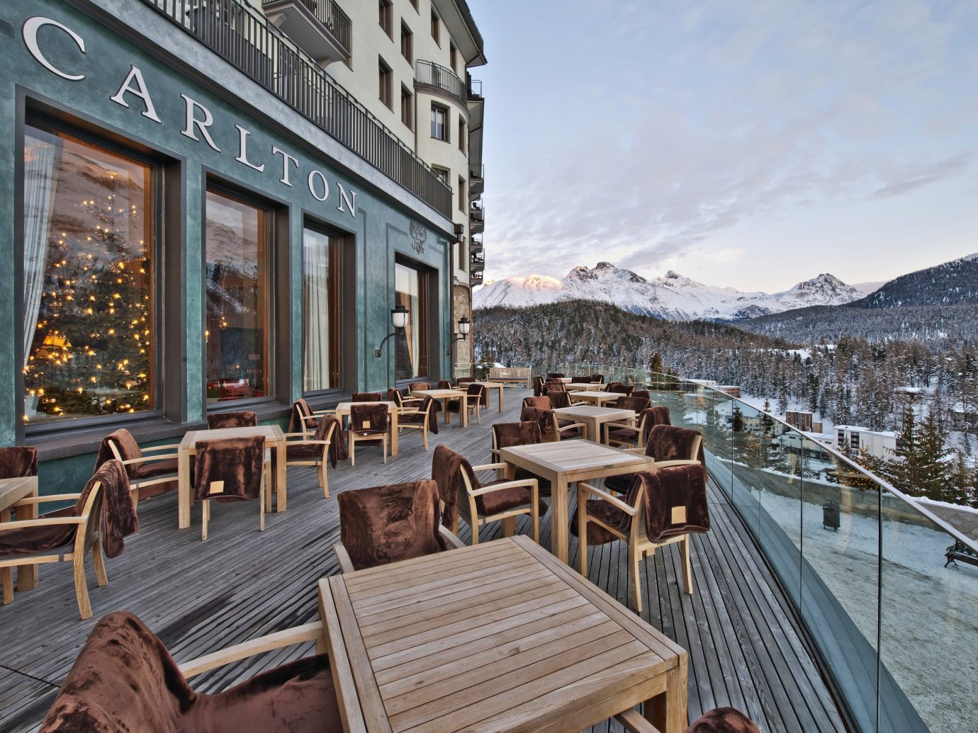Tables on a deck at the Hotel Carlton in St. Moritz Switzerland