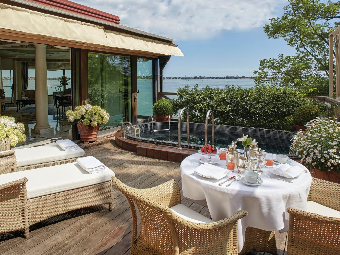 deck with chairs and a pool at Belmond Hotel Cipriani