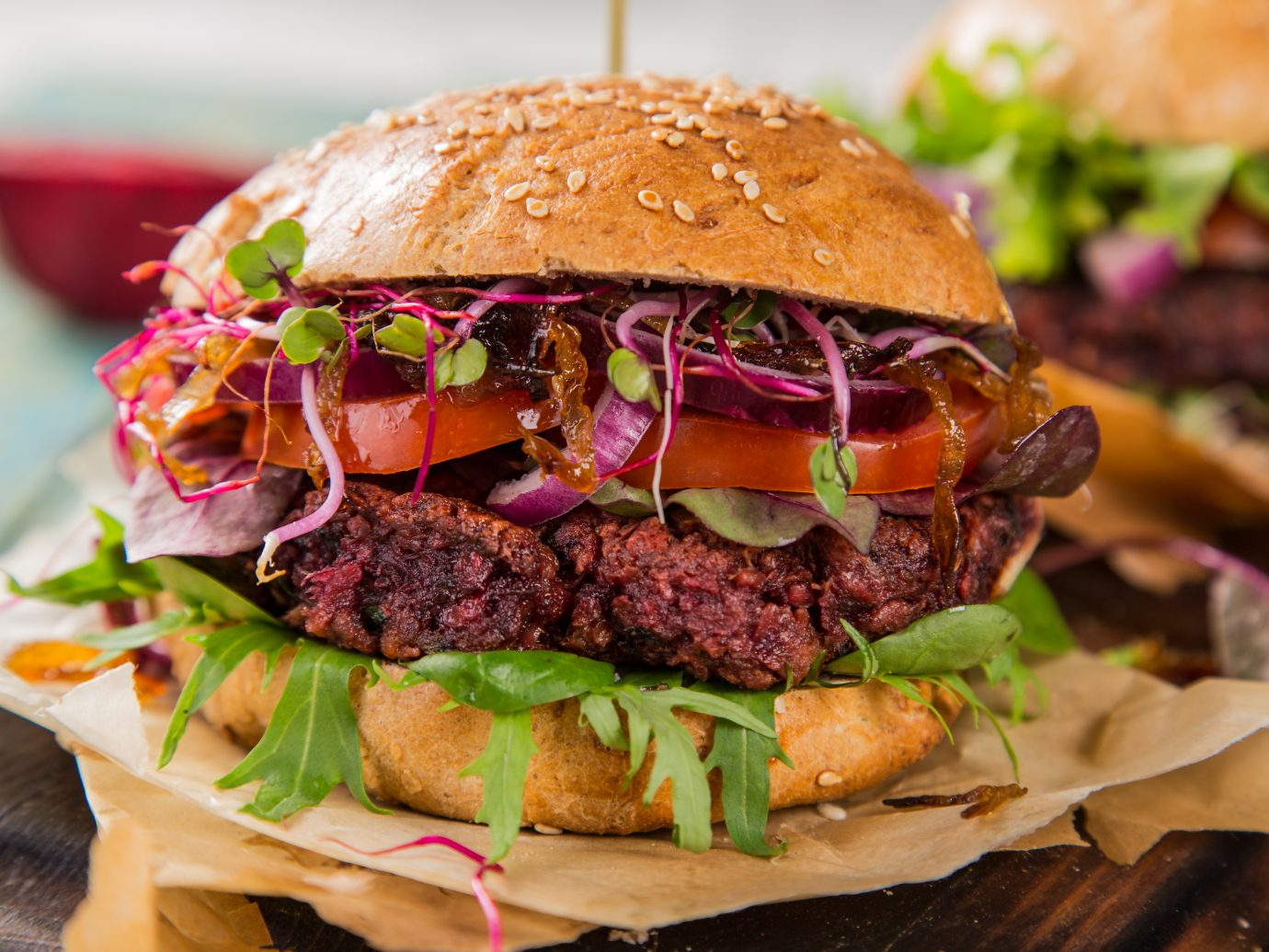 Close-up of home made vegetarian red beet burgers on wooden table at The Slutty Vegan, Atlanta, GA