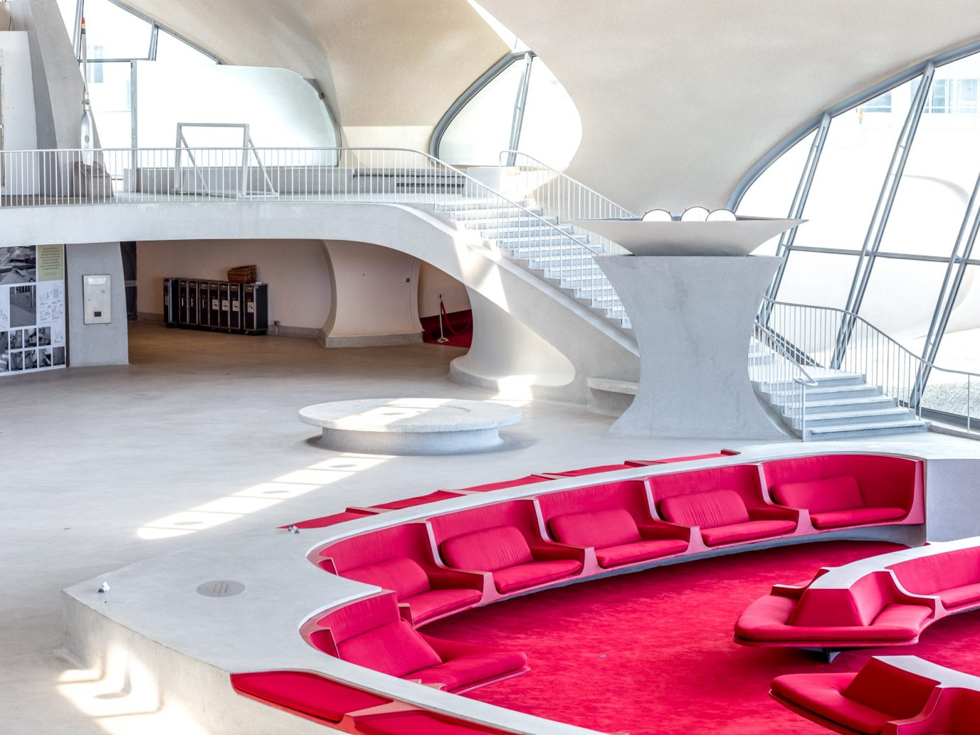 lobby with red seating in TWA Hotel
