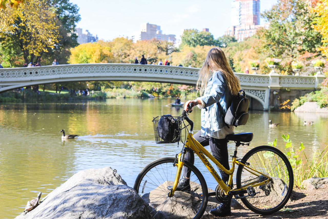 woman with a bike in central park