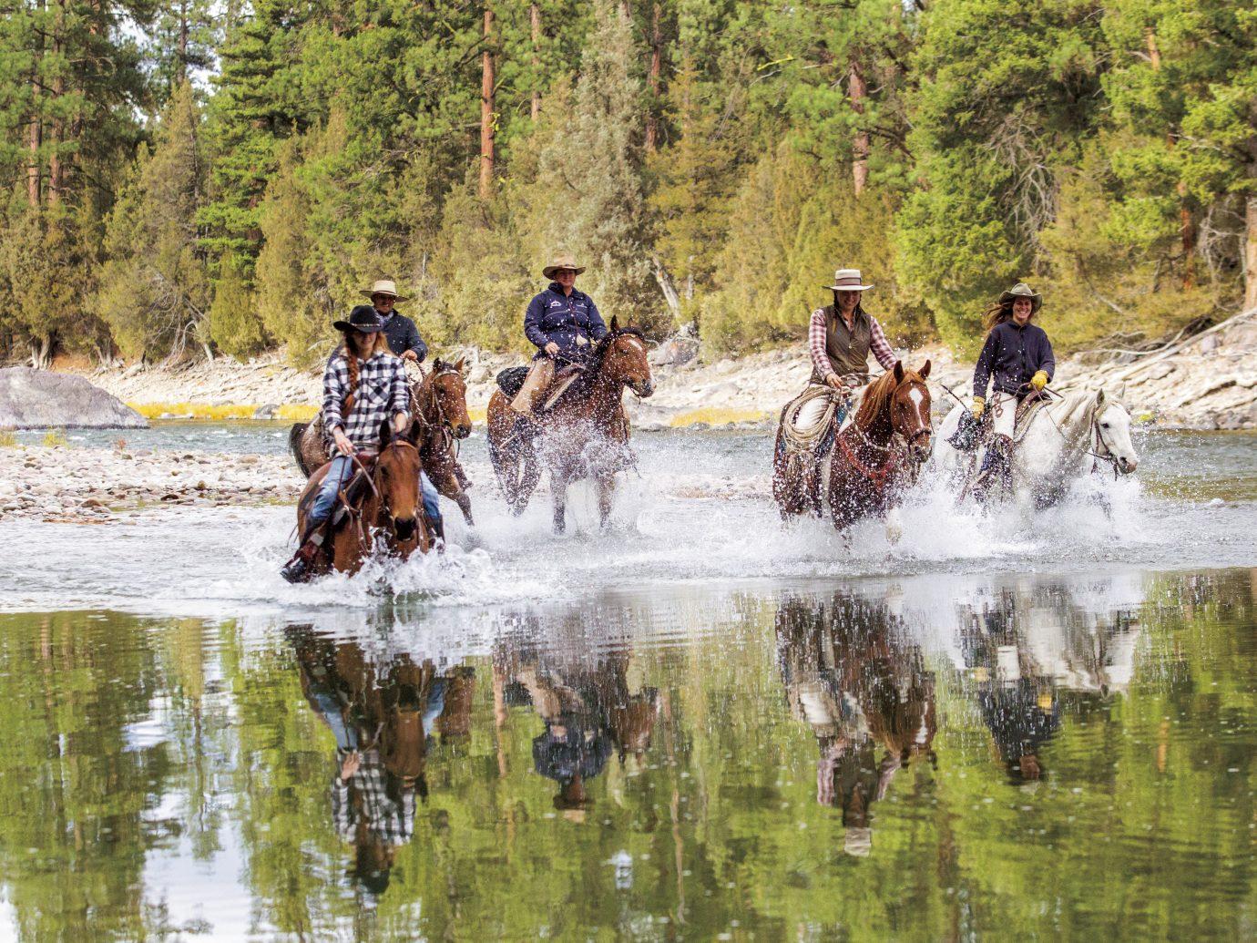 People horseback riding at The Resort at Paws Up, Montana