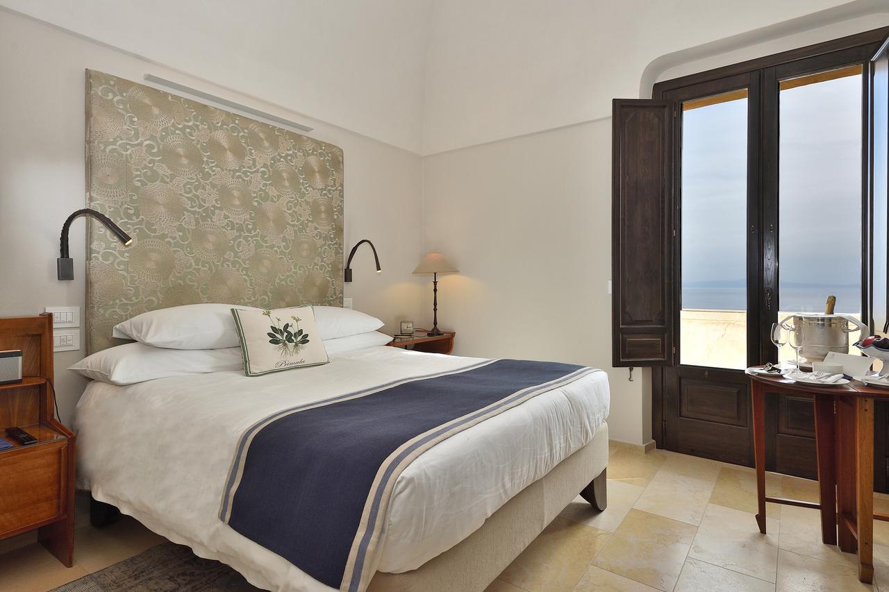 Bedroom at Monastero Santa Rosa Hotel & Spa