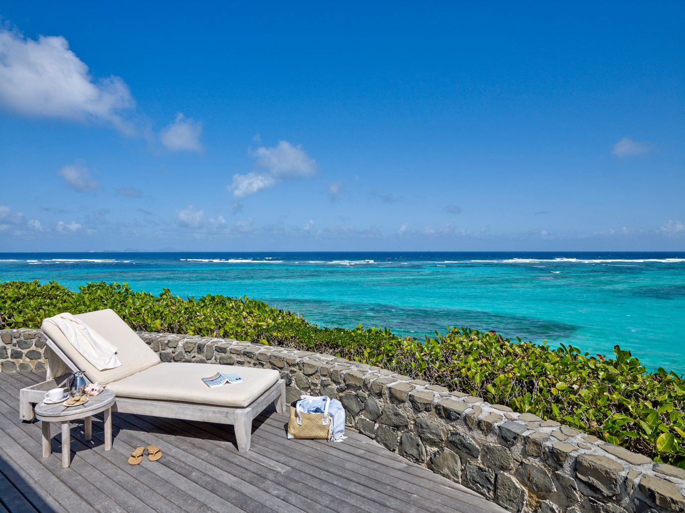 Lounge chair overlooking the ocean at Petit St Vincent