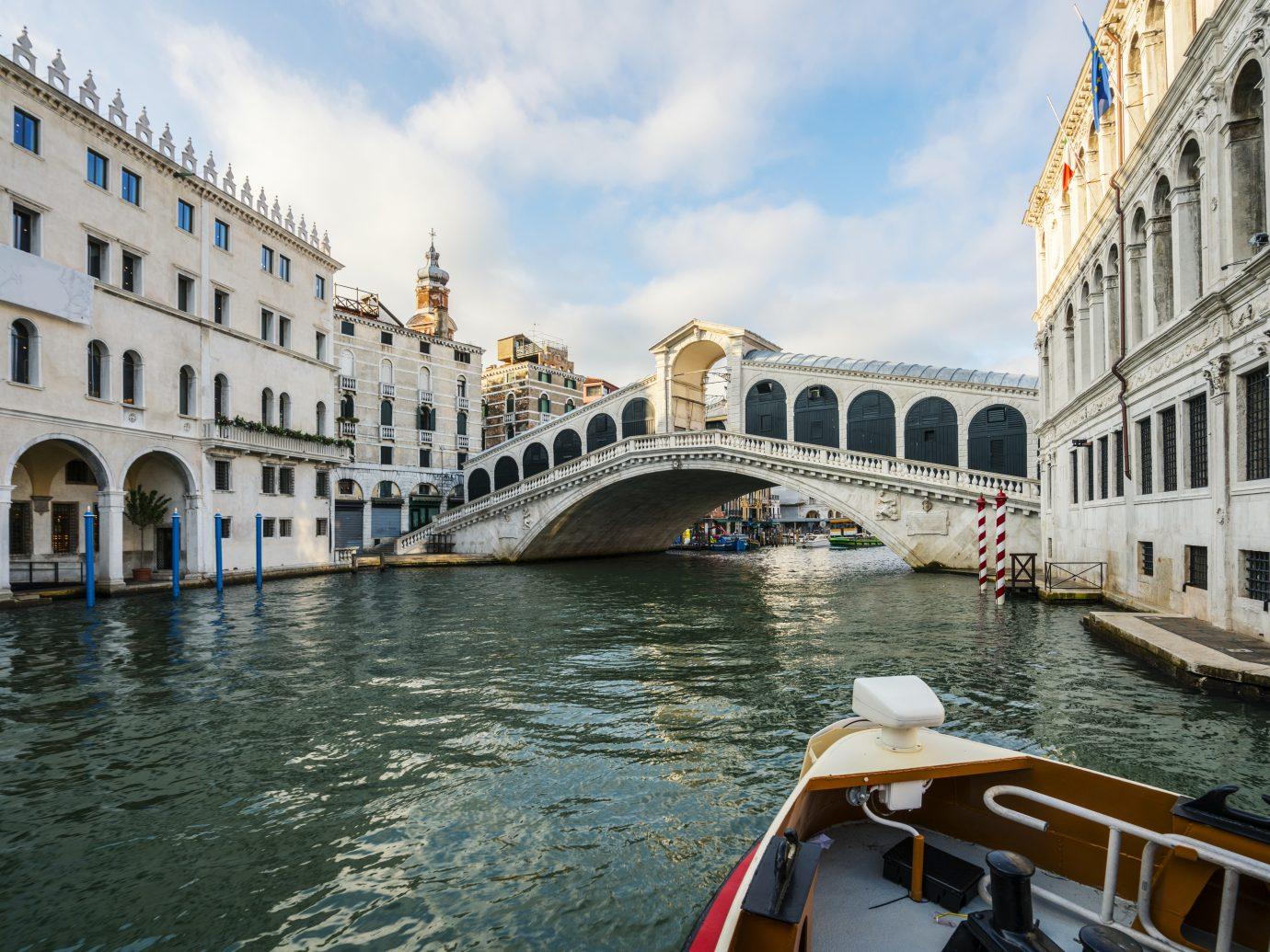 Boat On Grand Canal near famous Grand Rialto Bridge, Venice, Italy