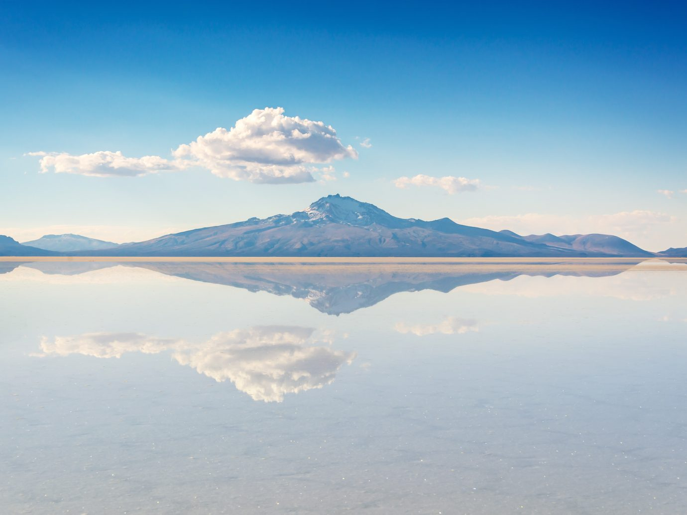 reflection of mountain in Salar de Uyuni (Uyuni salt flats), Potosi, Bolivia, South America
