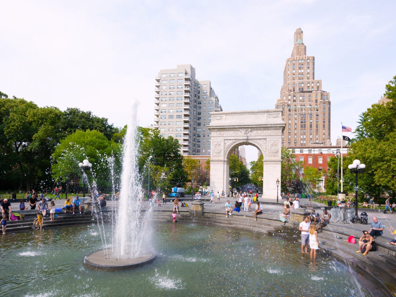 People meander about the fountain at Washington Square Park near the Washington Square Arch at Greenwich Village in the Manhattan borough of New York City.