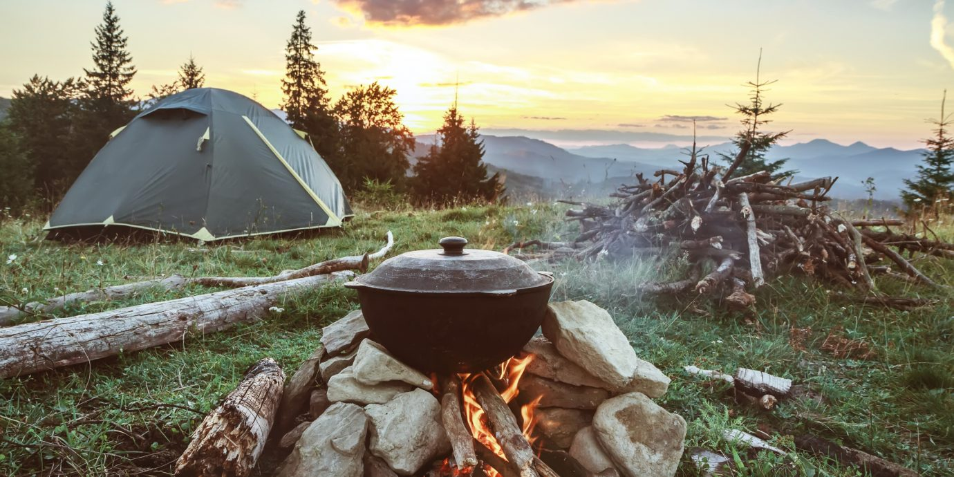 camping with fire, tent and firewood