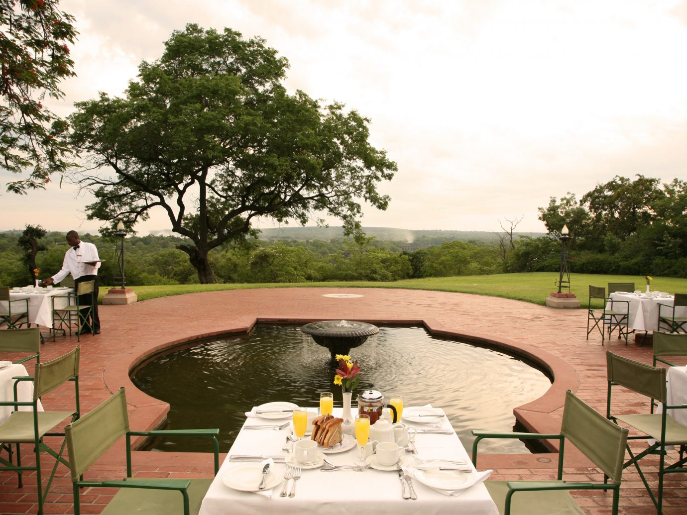 outdoor dining at Victoria Falls Hotel, Zimbabwe