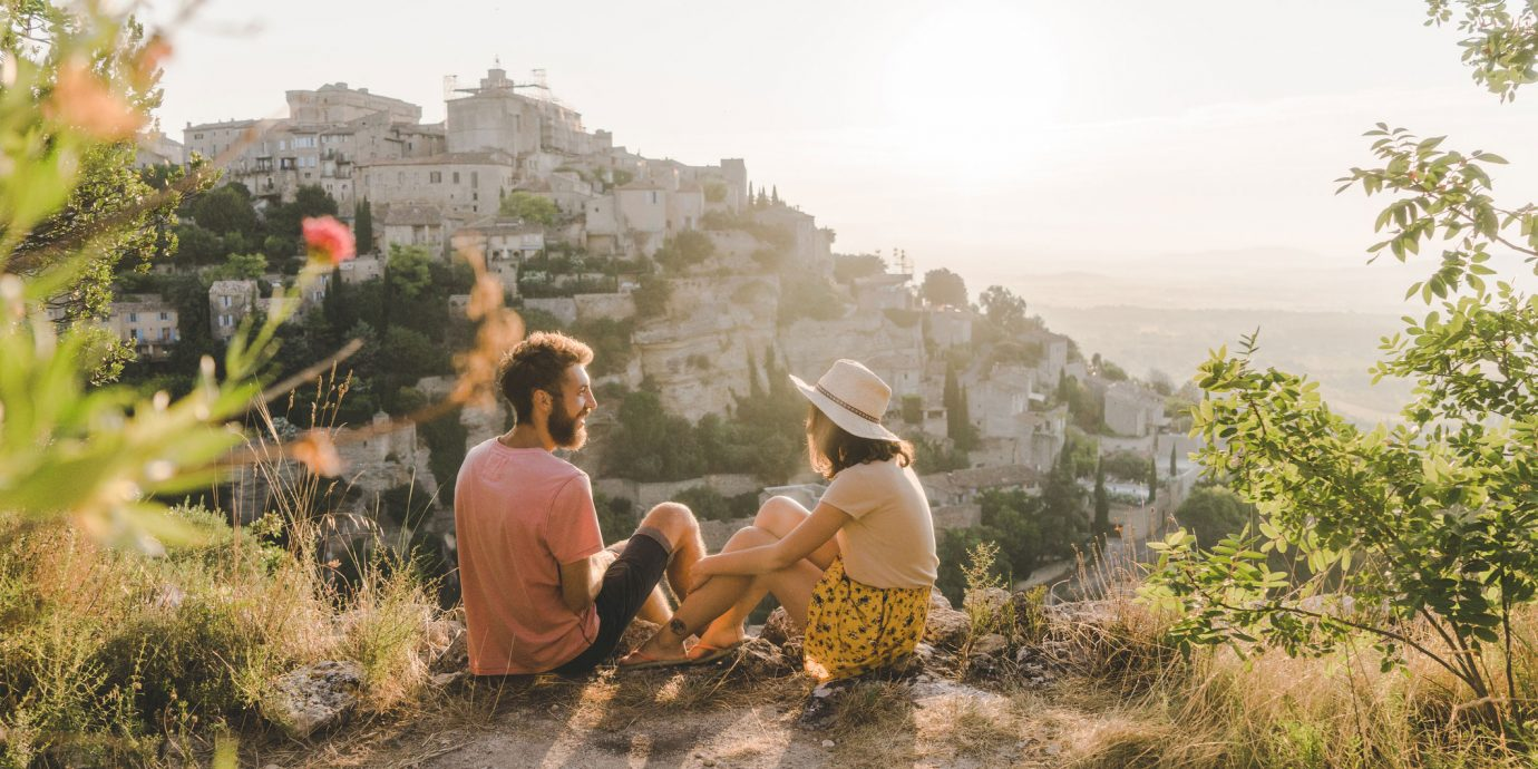 couple on a hilltop at sunset in europe