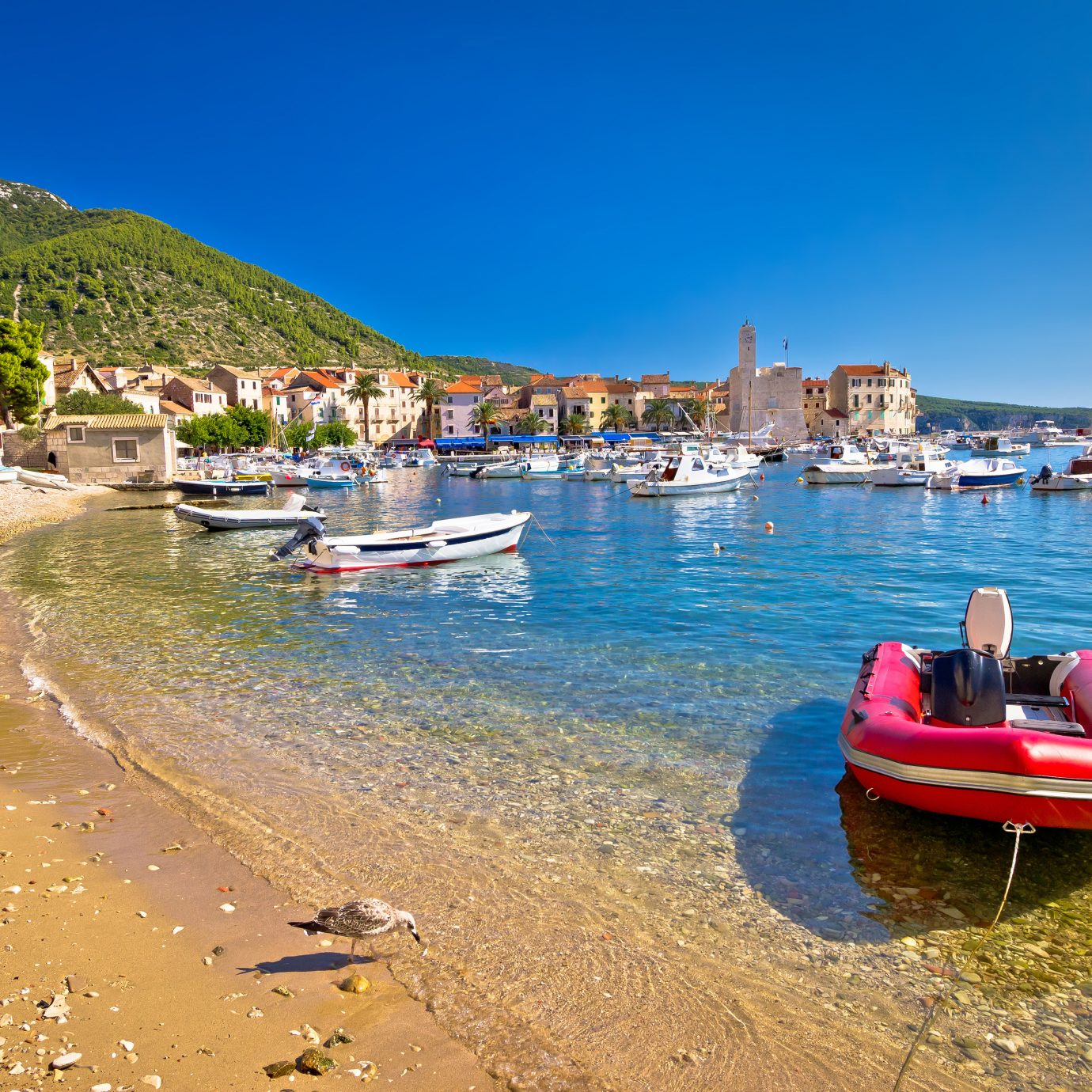 Sand beach in Komiza fishermen village, Island of Vis, Croatia