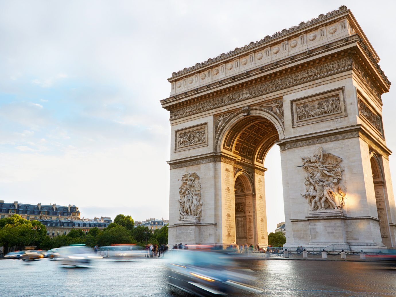 Arc de Triomphe in Paris, France. Traffic in the morning.