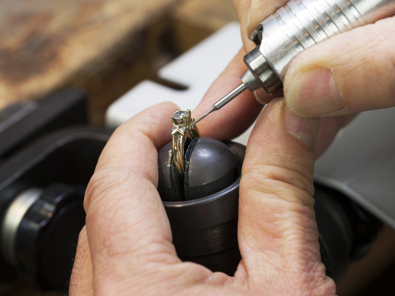 A Jeweller is Repairing a Diamond Ring.
