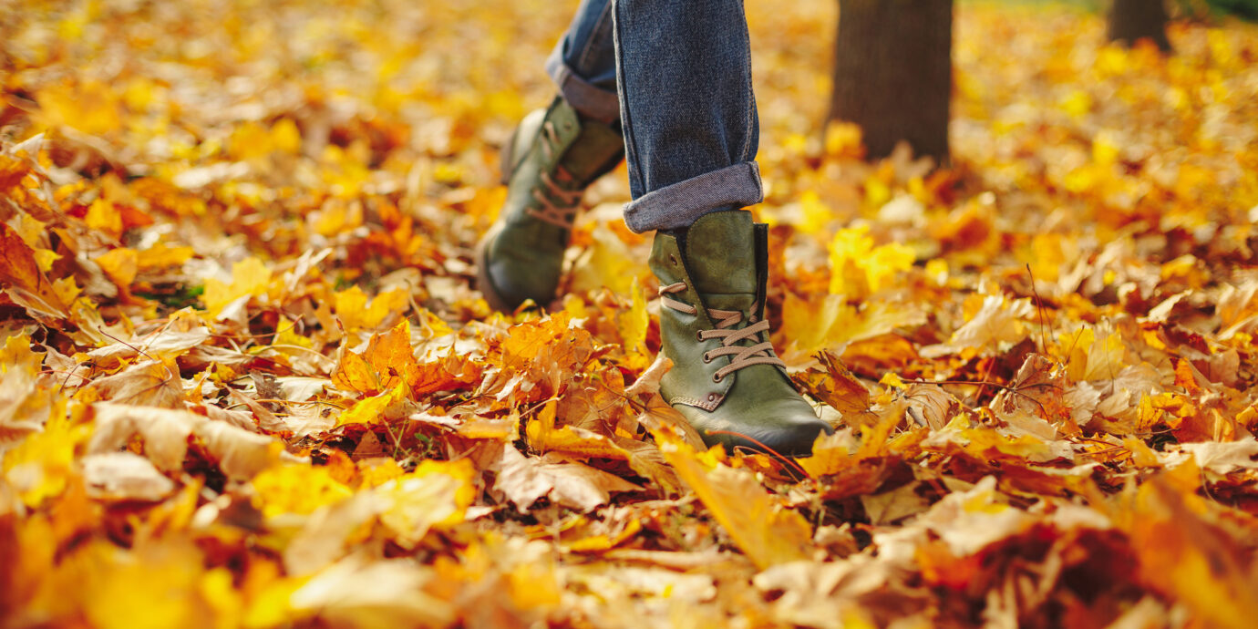Leather shoes walking on fall leaves outside